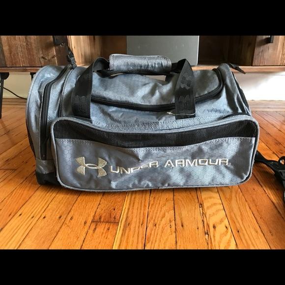 Under Armor Duffel Bag (includes shoulder strap). M 5ab7ea2161ca104963ded325 5ef03d332d